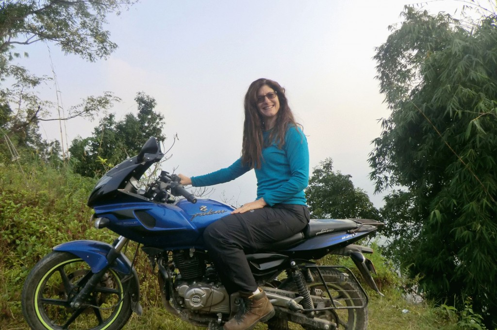 Michele on a return visit to India in 2013. This time on a more sedate Bajaj Pulsar motorbike