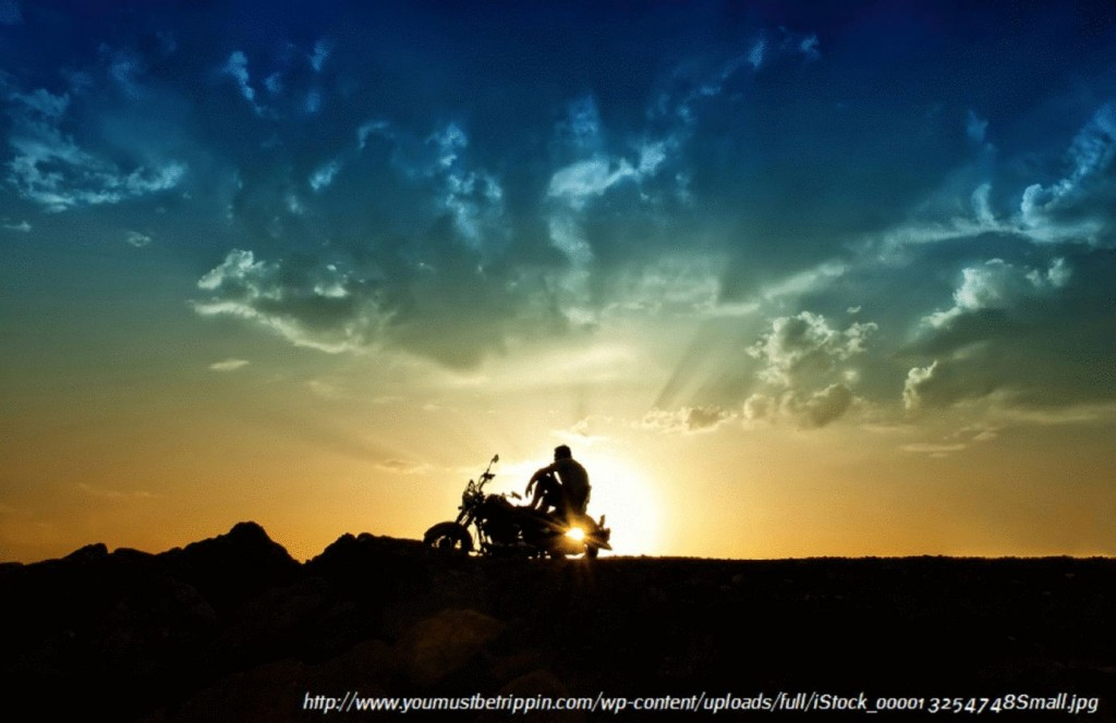 motorcycle and man against the background of sunset