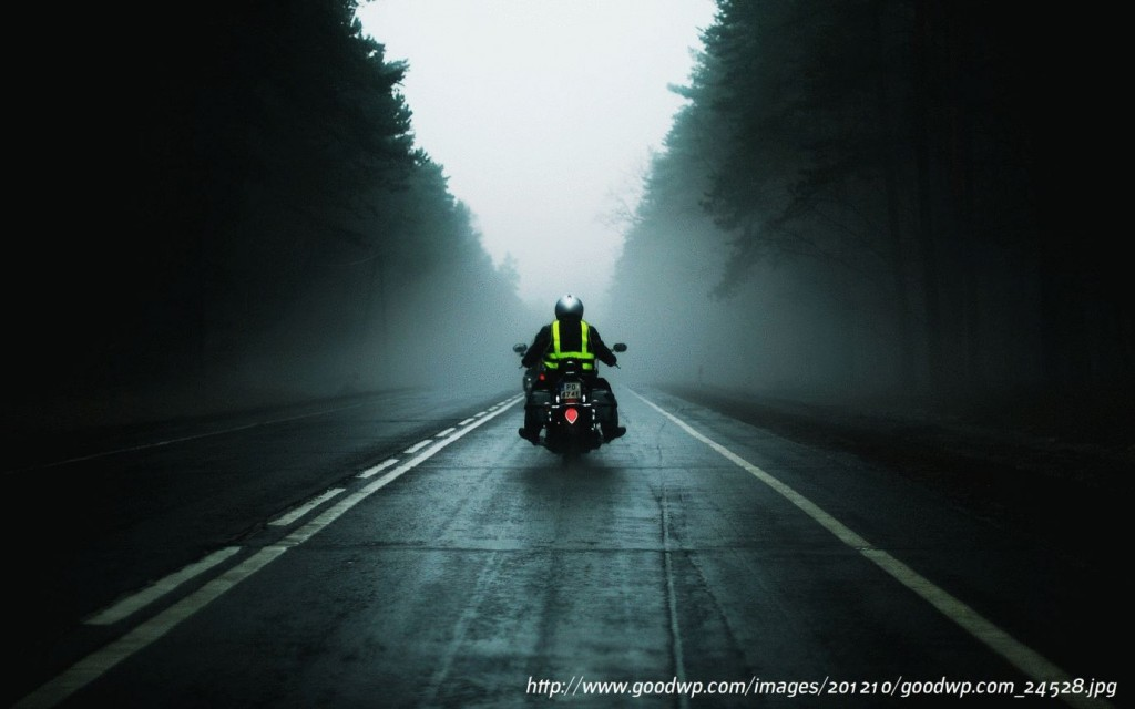 riding a morotcycle in a fog