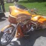 Yellow custom bagger motorcycle. August 20th 2016